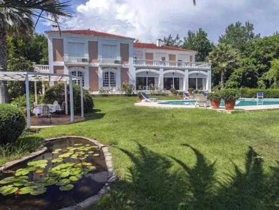 At A Distance Of 10 Km From The Centre Of Marmaris, Built With French Architecture Farm House Is For Sale.