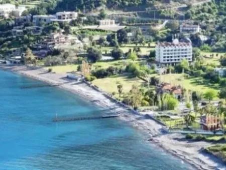 Marmaris,Den 18 Km Uzaklıkta 19000M2 Denize Sıfır Otel Arsamız Satılıktır.