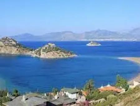 Datça İlçesi Kızlan Mevkisinde Denize Sıfır 10000M2 Turizm İmarlı Denize Sıfır Otel Yapımına Uygun Satılık Arsa